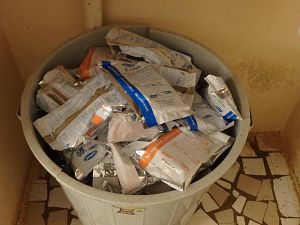 Garbage can full of F-100 and F-75  therapeutic milk products that are designed to treat severe malnutrition in a clinic in Matam, Senegal.